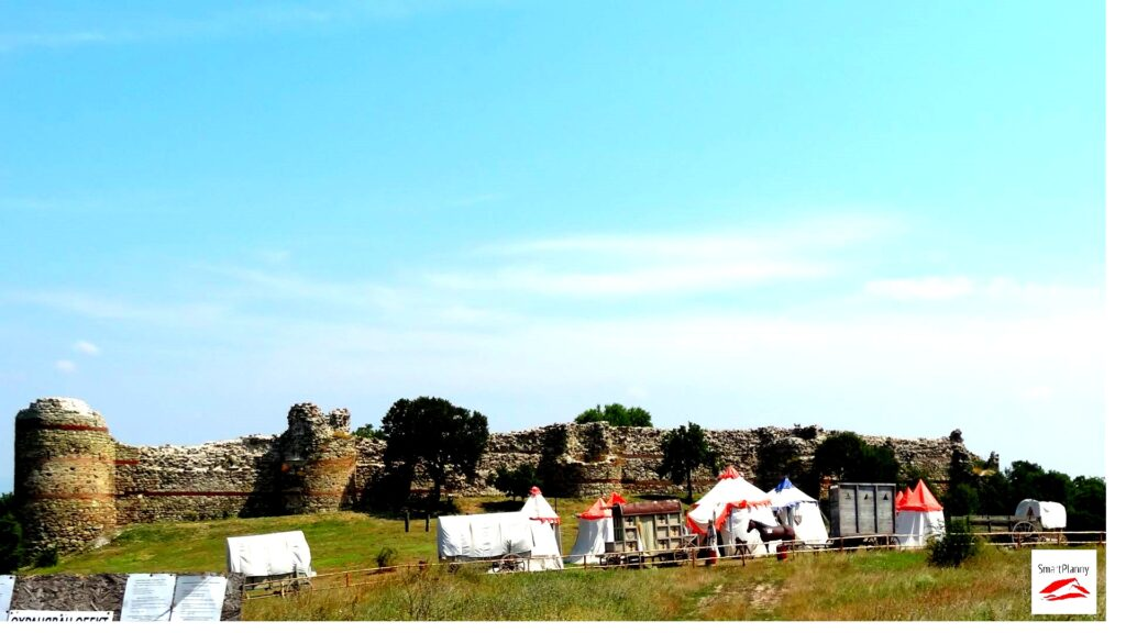 Mezek Fortress with а restoration of medieval gathering: tents, knights, horses, carts
